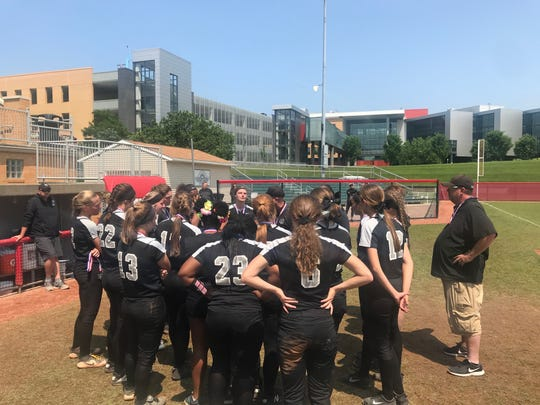 The Lakota East softball team gathered after the 14-10 loss in the Division I state championship game June 2 in Akron.