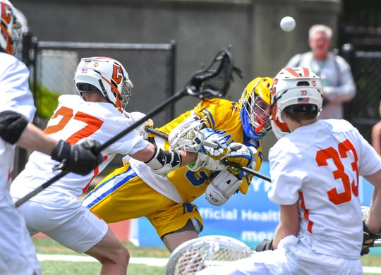 Josh McClorey of Mariemont launches the ball for a attempt on goal against Chagrin Falls at the DII Boys Lacrosse Championships, Selby Stadium, Ohio Wesleyan University, Saturday, June 1, 2019