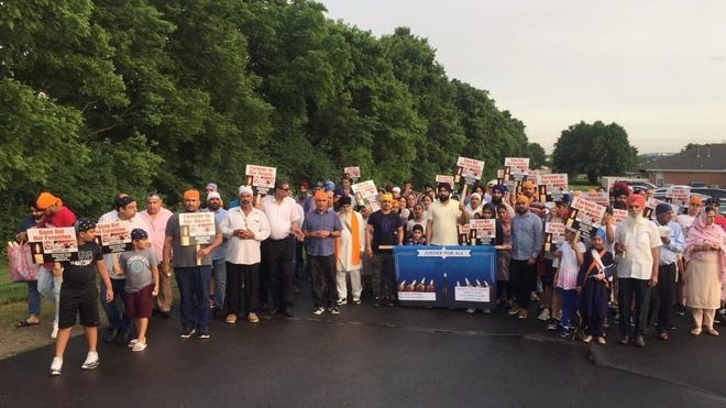 Members of the community and the Guru Nanak Society of Greater Cincinnati had a vigil Friday night to remember four members of a family killed more than a month ago and to demand answers.