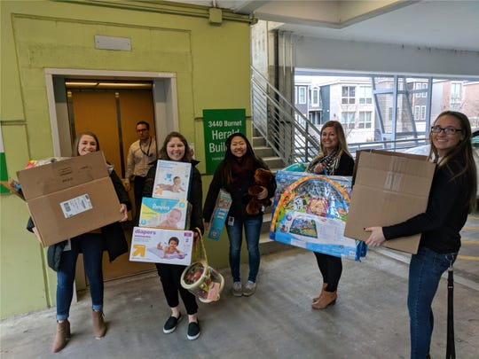 Myriad Neuroscience employees delivering toy drive donations at Cincinnati Children's Hospital Medical Center.