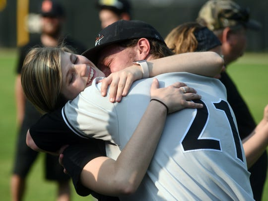 Ridgewood's Kaden Smith receives a hug following a 4-3 win against Minford in a Division III regional final on Saturday at Ohio Dominican.