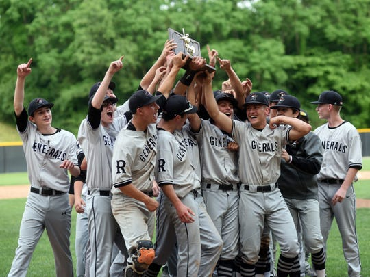 Ridgewood players celebrate with the trophy they received following a 4-3 win against Minford on Saturday in a Division III regional final at Ohio Dominican in Columbus.