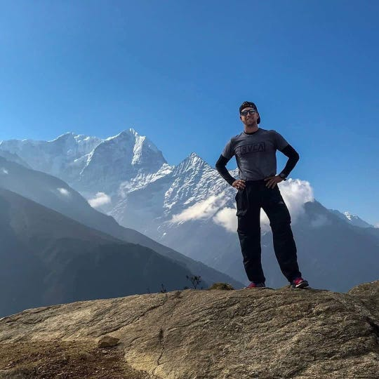 Chase Flack, 26, stands at Mt. Everest's basecamp, which he hiked two weeks before dying Saturday, June 1, 2019, after running the DAM to DSM marathan in downtown Des Moines.