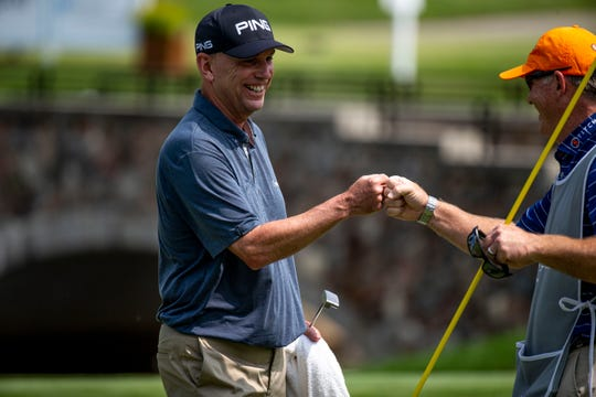 Kevin Sutherland fist bumps his caddy after finishing the 17th hole during the championship round of the Principal Charity Classic on Sunday, June 2, 2019, at Wakonda Club in Des Moines. Sutherland won the tournament after two playoff holes.
