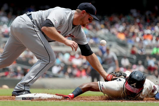 Tigers first baseman John Hicks misses the ball on a pick off attempt of Braves left fielder Ronald Acuna Jr. at first base in the first inning on Sunday, June 2, 2019, in Atlanta.