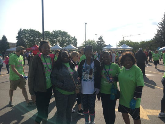 Ashley Kebede, Latrina Hill, Angela Harris, Nicole Johnson, and Patricia Horton participate at the 40th annual Stampede Scleroderma at the Detroit Zoo on Sunday.