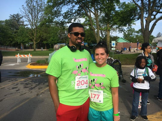 Kristoffer Butler and team leader Victoria Thompson Horton participate at the 40th annual Stampede Scleroderma at the Detroit Zoo on Sunday.