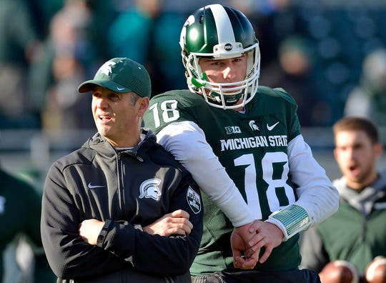 Brad Salem, shown here with former Michigan State quarterback Connor Cook, has been on Michigan State's coaching staff since 2010.