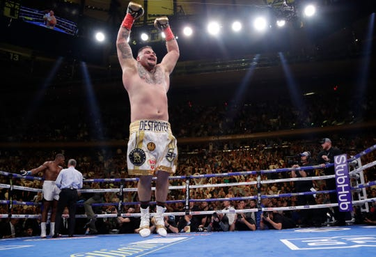 Andy Ruiz Jr. celebrates after stopping Anthony Joshua during the seventh round of a heavyweight championship boxing match Saturday in New York.