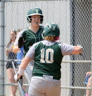 Vestal's Morgan Gendron (left) is congratulated by teammate Grace Talbot after scoring a run against Union-Endicott in the Section 4 Class A softball championship game June 1, 2019 at the BAGSAI Complex.