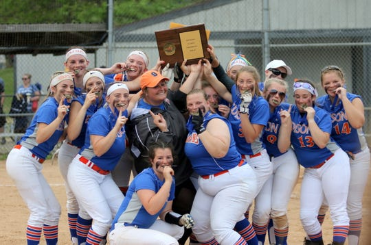 Thomas A. Edison players and head coach Liz Warren hold their championship plaque high after repeating as Section 4 Class C softball champions with a 9-0 win over Harpursville on June 1, 2019 at the BAGSAI Complex.
