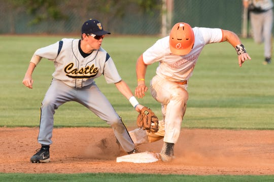 Castle's Grant McAtee (12) attempts to tag out Columbus East's Dalton Back (4) at second during the IHSAA Class 4A Championship baseball game at Bosse Field Saturday, June 1, 2019.