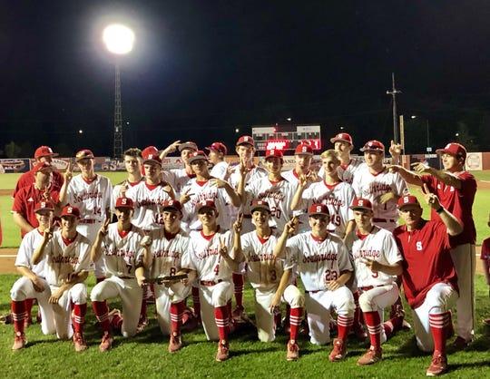 The Southridge High School baseball team gathers for a team photograph after winning the Class 2A regional.
