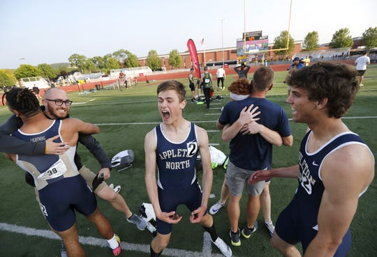 The Appleton North 1,600-meter relay team celebrates its first-place win Saturday.
