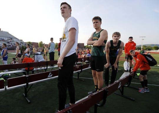 The D.C. Everest 1,600-meter relay team watches as Appleton North and Bay Port beat their race time during a re-run of the relay Saturday.