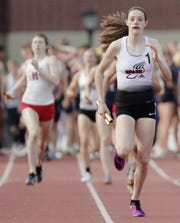 Stevens Point's Roisin Willis runs in the Division 1 1,600 relay at the WIAA state track and field meet Saturday at Veterans Memorial Field in La Crosse.