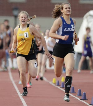 Freedom's Gabby Johnson, left, runs in the Division 2 1,600-meter relay Saturday at the WIAA state track and field meet at Veterans Memorial Field in La Crosse.