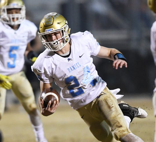 Daniel quarterback Tyler Venables (24) rushes against Greer in the class AAAA upstate championship Friday, November 30, 2018 at Greer's Dooley Field. Venables has committed to play college football at Clemson.
