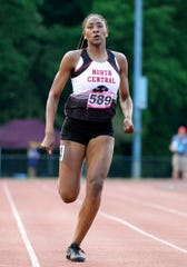 North Central's Ramiah Elliott crosses the finish line in the 200 meter dash during the girls IHSAA track and field state finals at Robert C. Haugh Track and Field complex in Bloomington, Ind. on Saturday, June 1, 2019.
