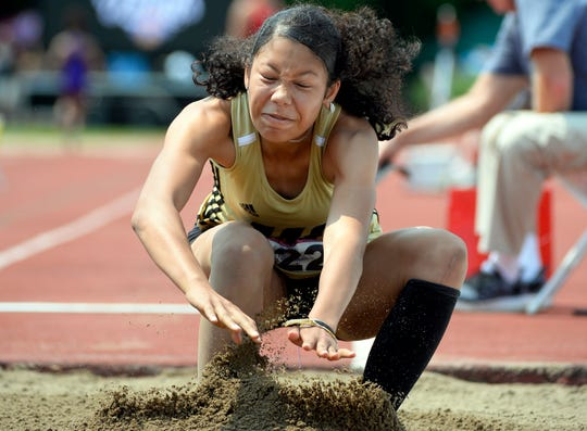 Warren Central's Prommyse Hoosier competes in the long jump during the girls IHSAA track and field state finals at Robert C. Haugh Track and Field complex in Bloomington, Ind. on Saturday, June 1, 2019.