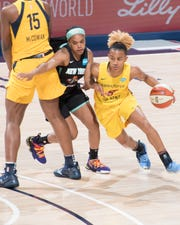 Fever rookie Paris Kea (right) made her pro debut Saturday with 10 points on 4-of-6 shooting.