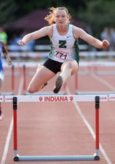 Zionsville's Ella Robinson competes in the 300 meter hurdles during the girls IHSAA track and field state finals in Bloomington on Saturday.