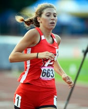 Pike's Elizabeth Stanhope runs in the 800 meters during the girls IHSAA track and field state finals in Bloomington on Saturday.