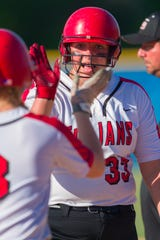 FILE – Abby Herbst (33) starred on the mound and at the plate for Center Grove in the Trojans' semistate win over Brownsburg on Saturday.