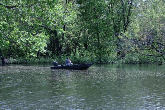A man fishes on Big Woods Lake in Cedar Falls, Iowa on May 21, 2019.