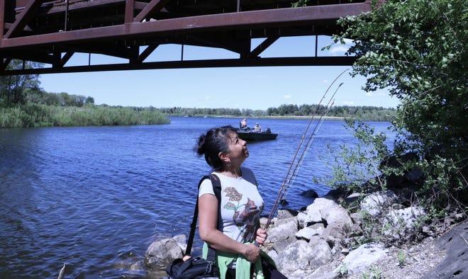 Maria Christensen, of Waterloo, Iowa, fishes at Big Woods Lake in Cedar Falls, Iowa, on May 21, 2019.