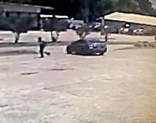 This is a surveillance image of a vehicle a suspect exited just before a fatal shooting on Medgar Evers Blvd. on Saturday, June 1, 2019. The vehicle is a dark-colored four-door sedan, possibly a Nissan.