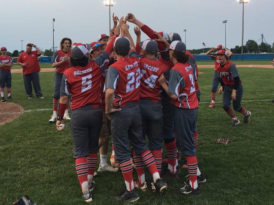 Rossville players celebrate the Class A regional championship