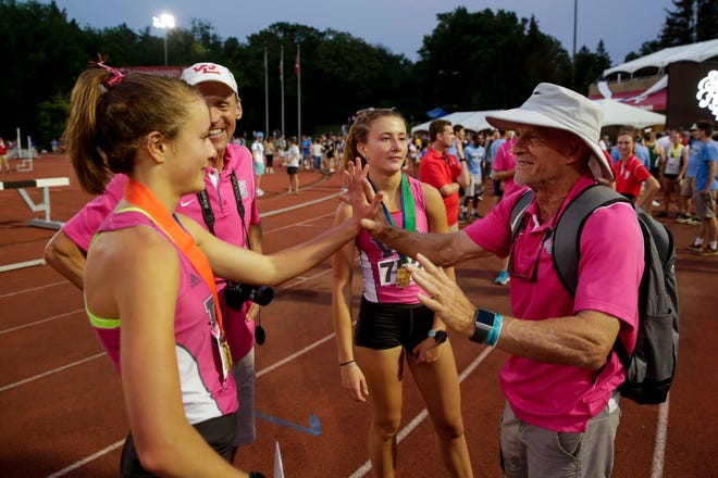 West Lafayette head coach Lane Custer and Emma Tate react after placing fourth in the IHSAA Girls Track & Field State Finals, Saturday, June 1, 2019, at Indiana University's Robert C. Haugh Track & Field Complex in Bloomington.