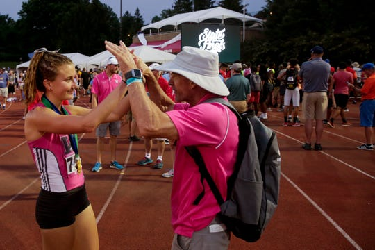 West Lafayette head coach Lane Custer and Ellie Tate react after placing fourth in the IHSAA Girls Track & Field State Finals, Saturday, June 1, 2019, at Indiana University's Robert C. Haugh Track & Field Complex in Bloomington.