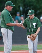 Trinity head baseball coach Richard Arnold hands the ball to relief pitcher Trent Youngblood in the bottom of the 5th inning. June 01, 2019.