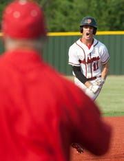 As his father Sherman, the third-base coach, waits to greet him, PRP shortstop Reed Blaszczyk rounds the bases after hitting a three-run home run Saturday in the Semistate Three game against Taylor County at Eastern High School. (Photo by David Lutman, Special to the Courier Journal.)