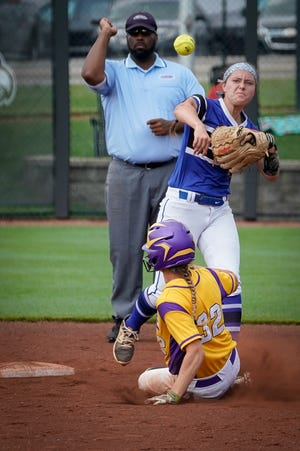 """Oldham County's Emily Lindell (14) turns a double play after tagging out Male""""s Megan Konermann (32) during the KHSAA Semi-State Softball Game played at the University of Louisville in  Louisville, Ky., Saturday, Jun 1, 2019."""