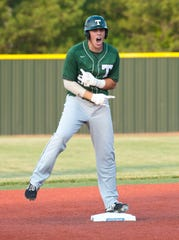 Trinity's Davis Crane reacts to his line drive double to center field in the KHSAA baseball Semistate 4 game. The hit drove in two runs in the top of the 3rd inning. June 1, 2019