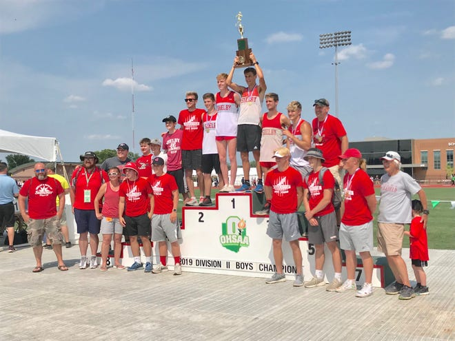 The Shelby boys track and field team celebrates its 2019 Division II state title.
