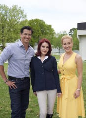"""Wes, Priscilla and Kellie hang near the Graceland stables during the shooting of """"Wedding at Graceland."""""""