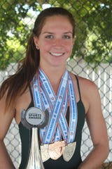 Maddy Burt shows off some of her hardware earned down the years.
