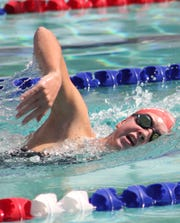 Maddy Burt alternates between freestyle and butterfly during her training sessions.