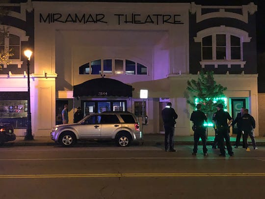 Police investigae a shooting Saturday night outside the Miramar Theatre, 2844 N. Oakland Ave.