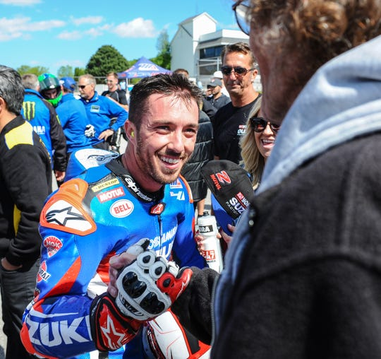 Josh Herrin is congratulated on his way to victory lane after winning the second Superbike race of the Dunlop Championship weekend at Road America.