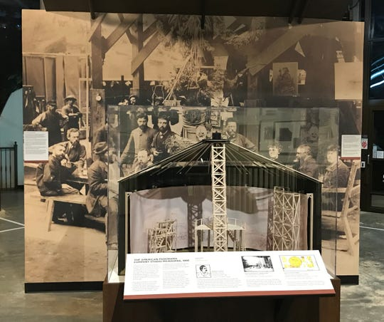 A re-creation of a model of the scaffolding used by Milwaukee artists of the American Panorama Co. is part of the new exhibit at the Atlanta History Center next to a large photo of the artists at work.