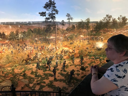 A visitor at the Atlanta History Center looks at the Battle of Atlanta cyclorama created in 1886 by Milwaukee artists.