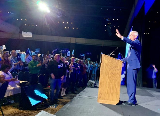 Gov. Tony Evers waves to a crowd of Democrats at the party's annual state convention at the Potawatomi Hotel and Casino in Milwaukee on Saturday.