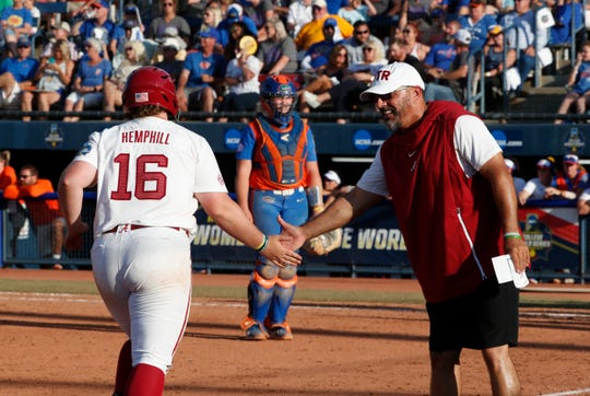 Alabama head coach Patrick Murphy, right, congratulates junior Bailey Hemphill (16) after a fourth-inning home run, her record-breaking 26th of the season, to send the Crimson Tide to a 15-3 win over Florida in a Women's College World Series elimination game Saturday, June 1, 2019 from the USA Softball Hall of Fame Complex in Oklahoma City. (Photo by Robert Sutton/Alabama athletics)
