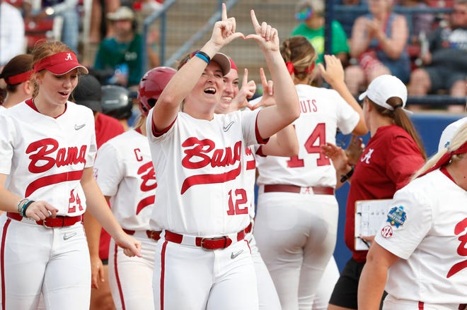 Alabama sophomore Kaylee Tow (12) signals to  Crimson Tide fans after Alabama's 15-3 win over Florida in the Women's College World Series elimination game Saturday, June 1, 2019 from the USA Softball Hall of Fame Complex in Oklahoma City. (Photo by Robert Sutton/Alabama athletics)