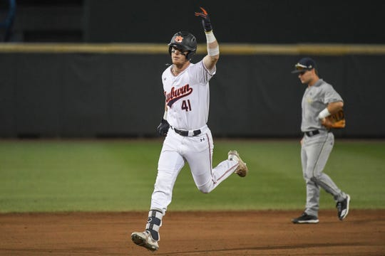 Auburn's Steven Williams (41) celebrates his walk-off home run against Georgia Tech during an NCAA Regional on Saturday, June 1, 2019, in Atlanta, Ga.